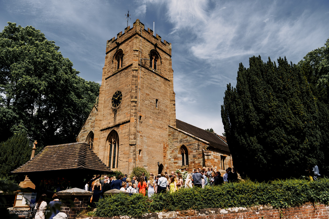 Wedding guests outside St Leonard's church Clent