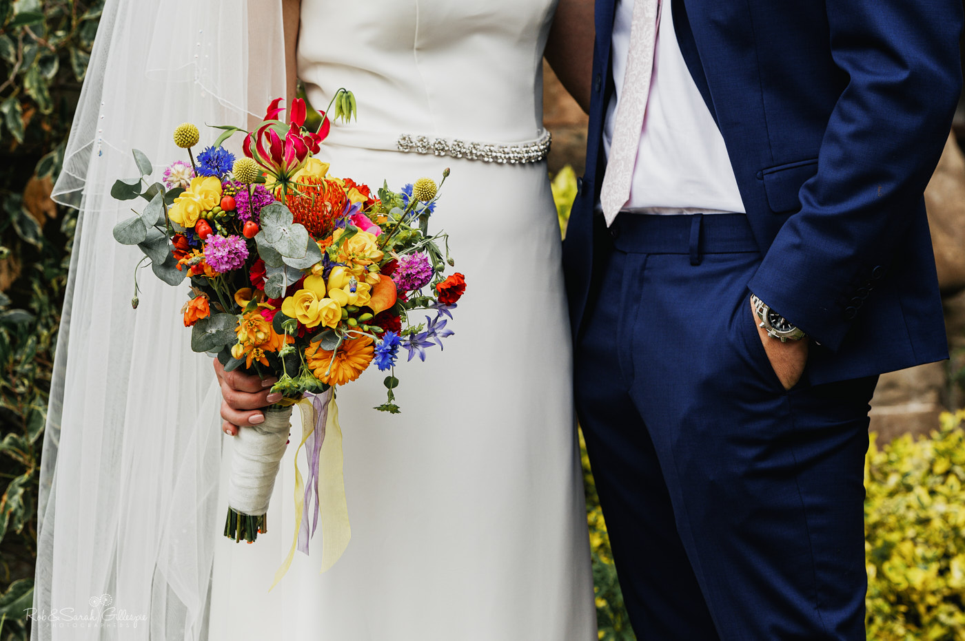Close-up of bride's bouquet feauting beautiful summer flowers