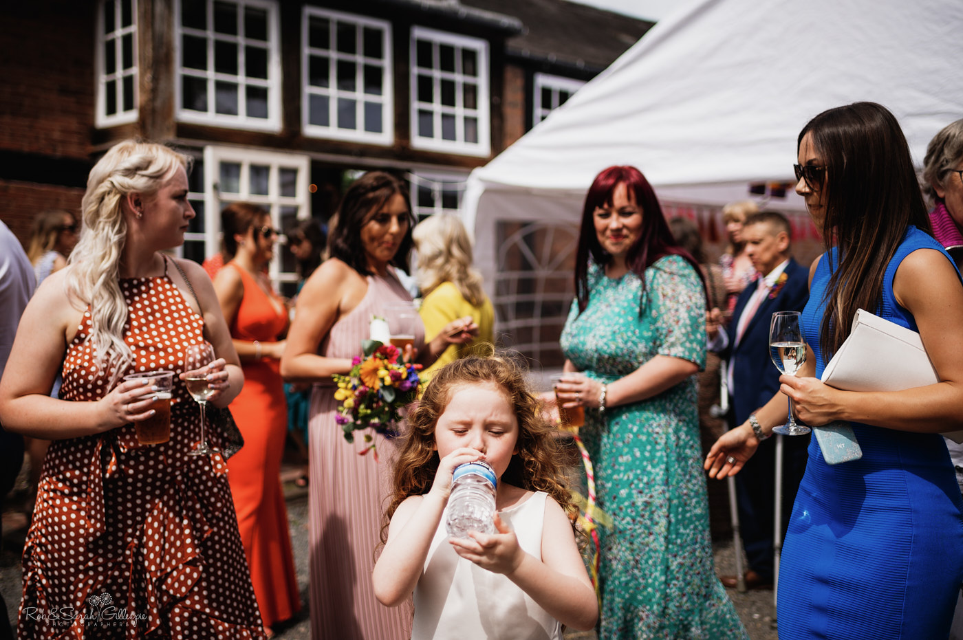 Wedding guests enjoy drinks reception at Belbroughton Church Hall in Worcestershire