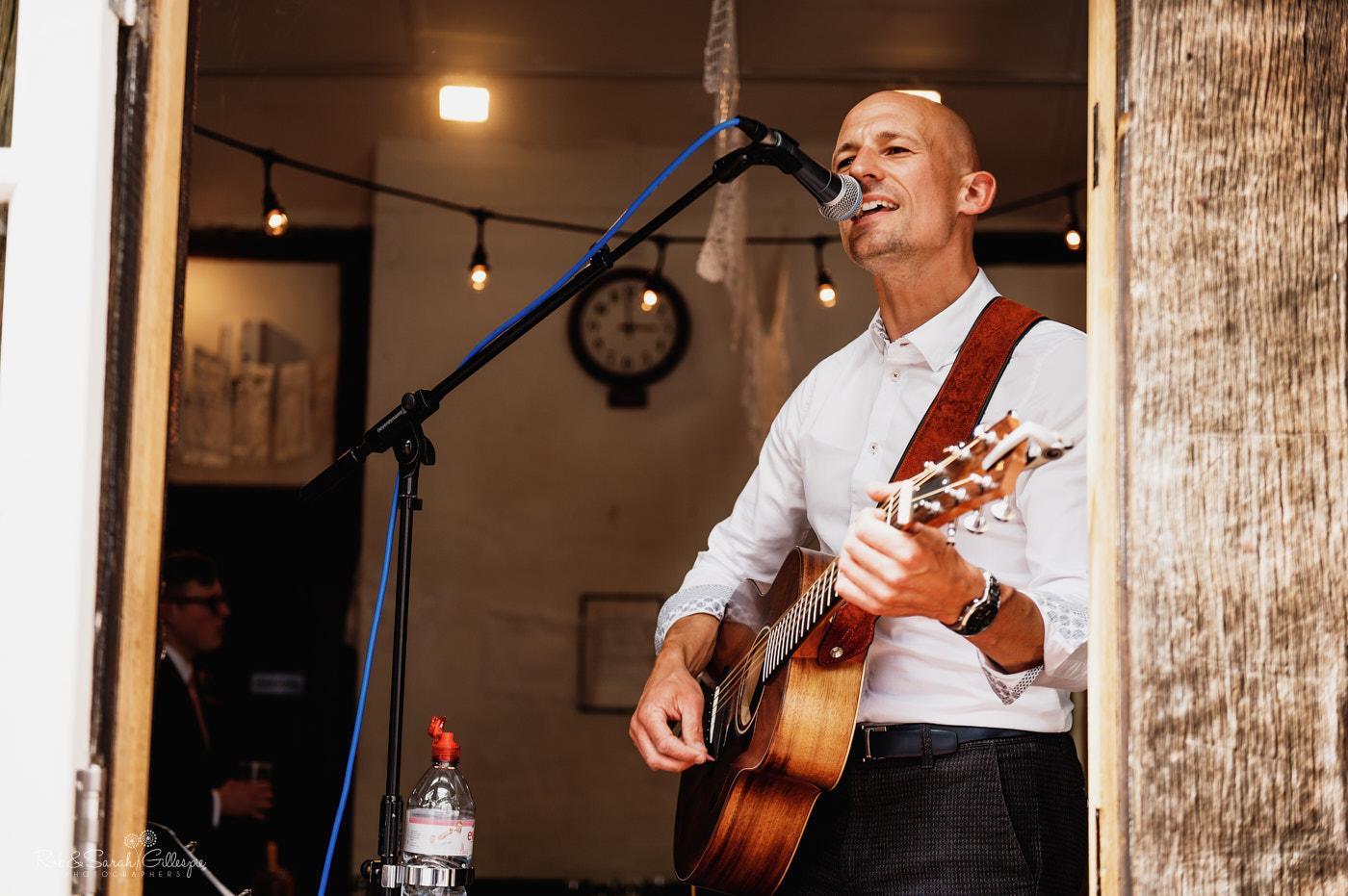 Musician plays at wedding reception at Belbroughton village hall