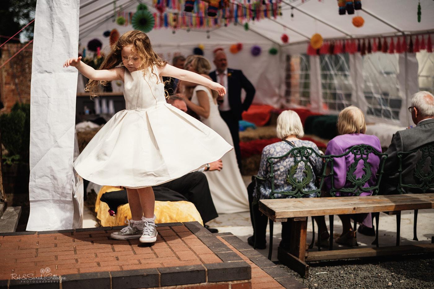 Flowergirl spins her dress at Belbroughton village hall