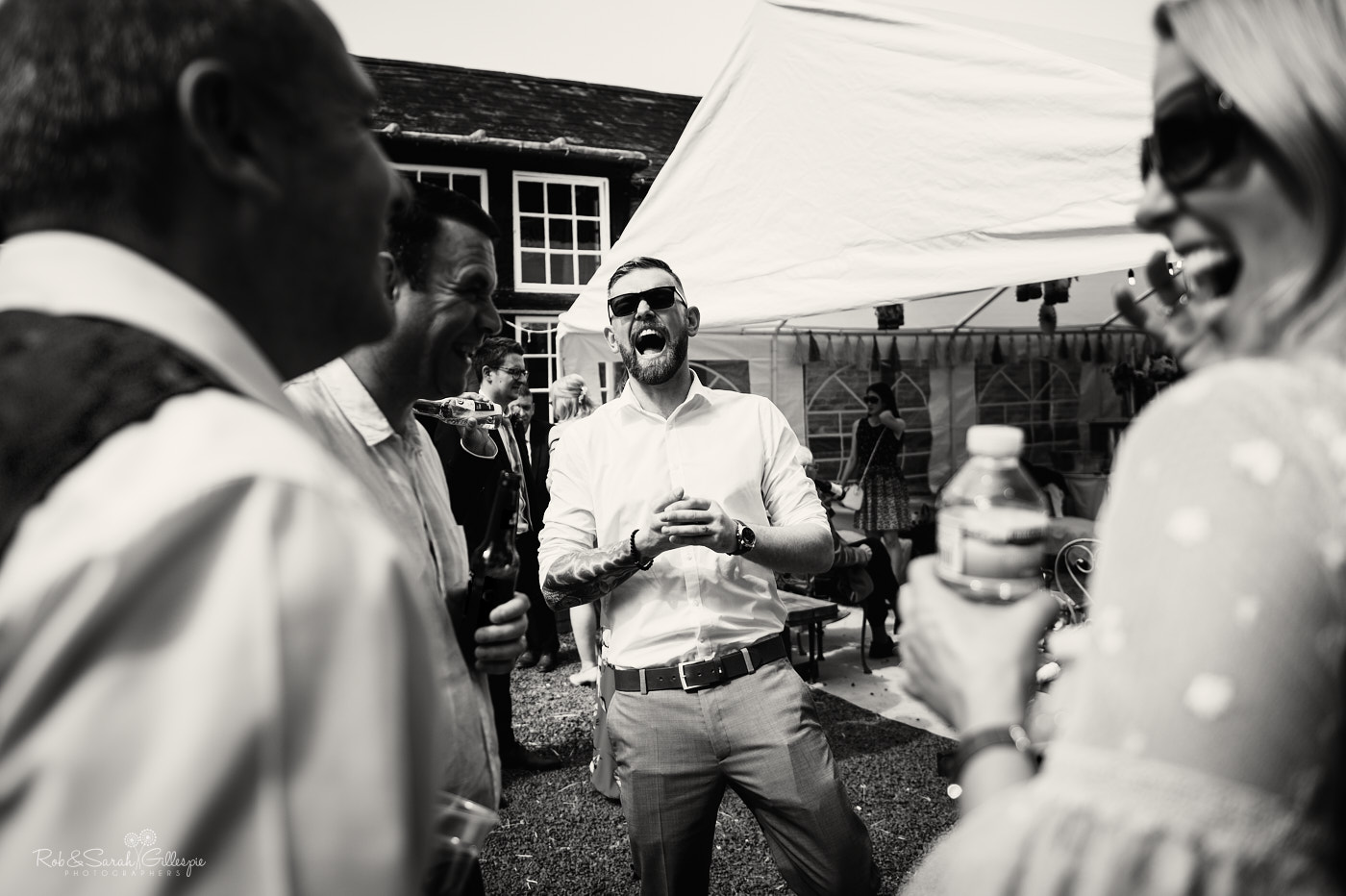 Guests relaxing at Belbroughton village hall wedding reception