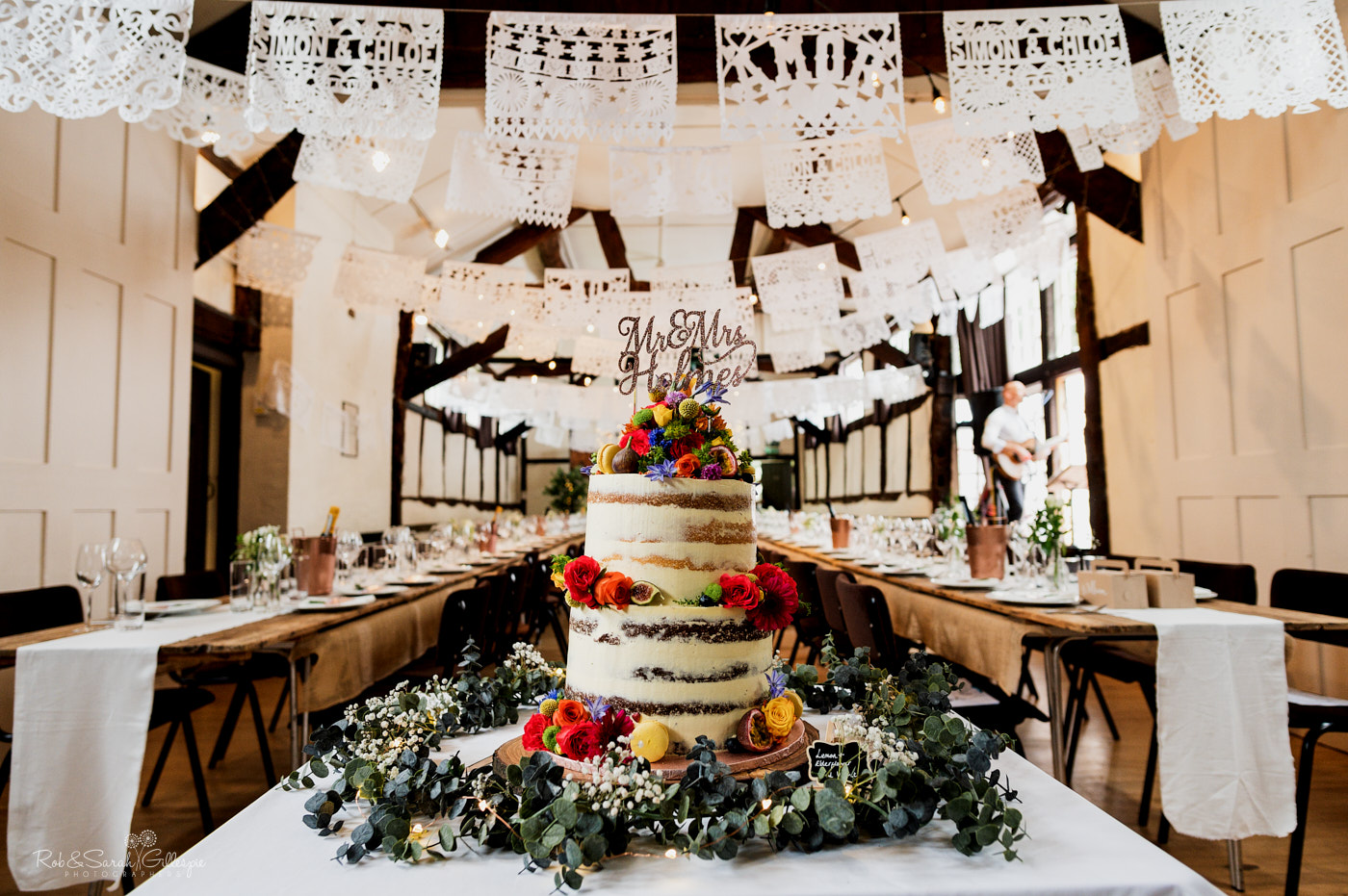 Belbroughton village hall decorated for wedding with gorgeous wedding cake