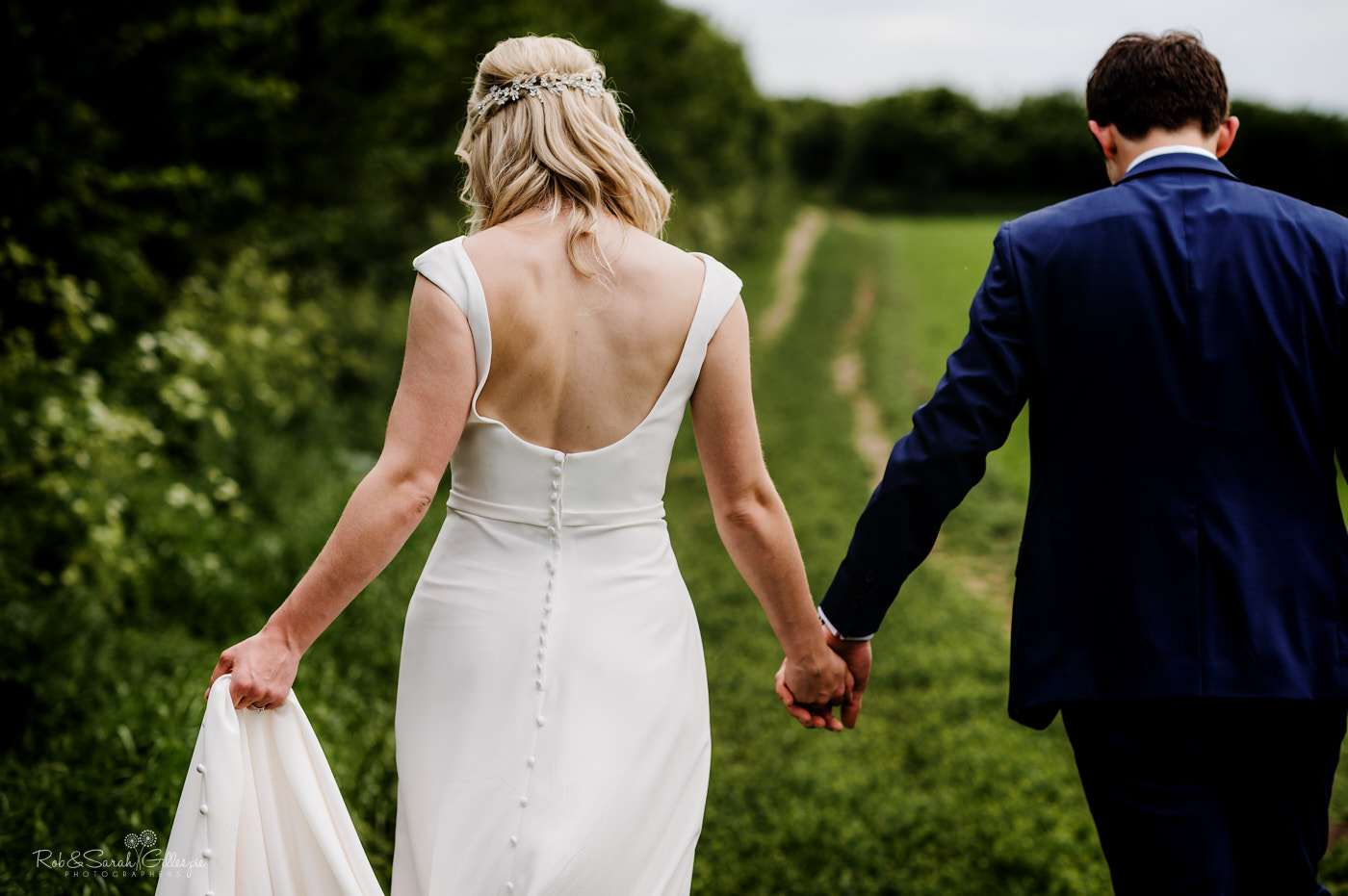 Wedding couple photos in field near village hall in Worcestershire