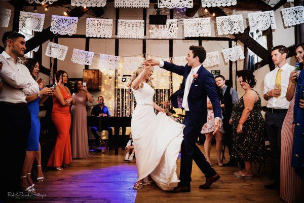 Bride & Groom first dance in village hall wedding reception