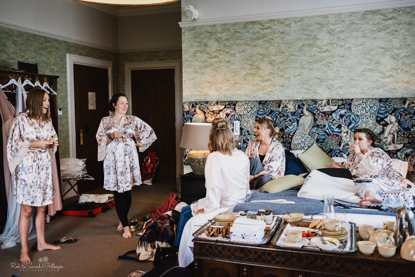 Bridesmaids relax as they prepare for wedding at Hampton Manor