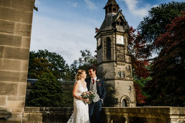 Bride and groom laughing together at Hampton Manor