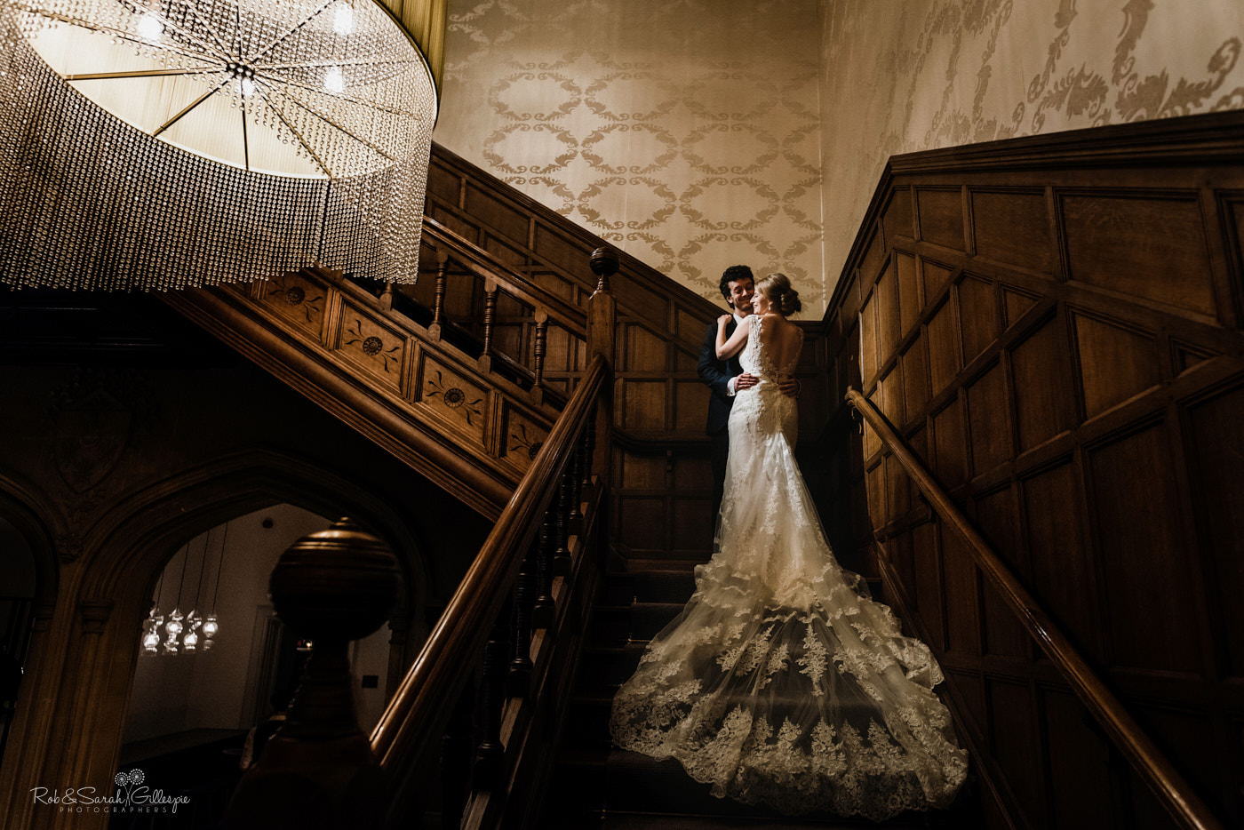 Newlyweds on staircase at Hampton Manor