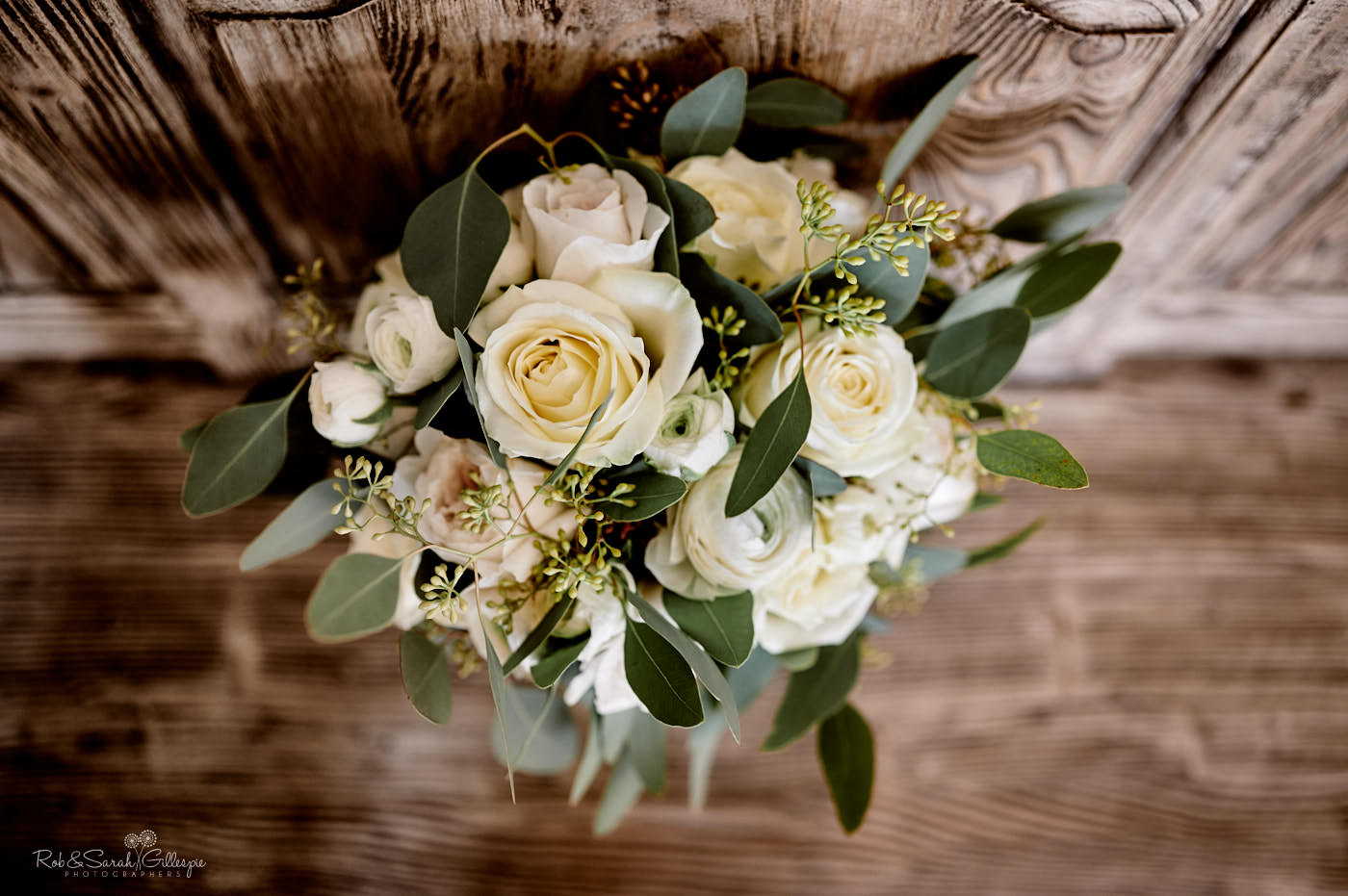 Bridal bouquet on wooden bench