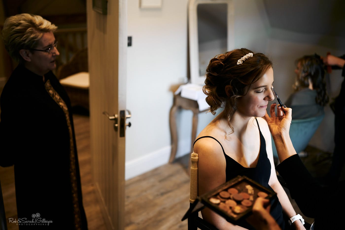 Bride prepares for wedding in Dressing Room at Lapstone Barn