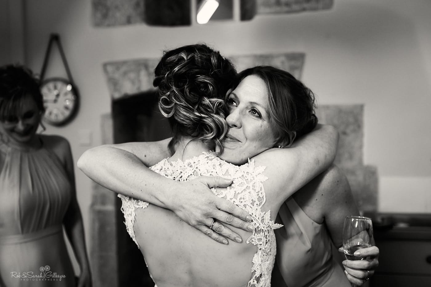Bridesmaids hugs bride