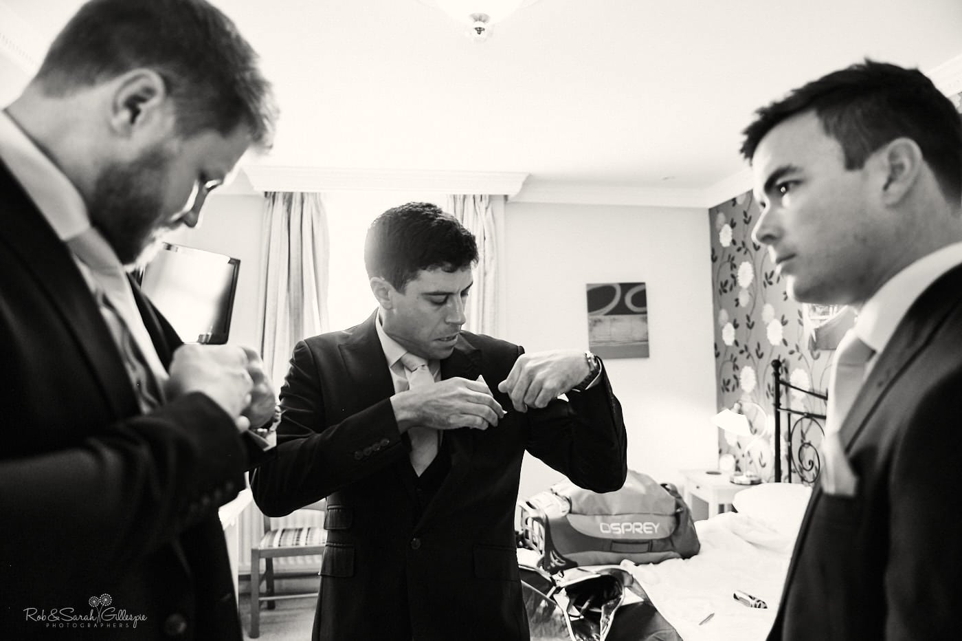 Groom and groomsmen get ready for wedding
