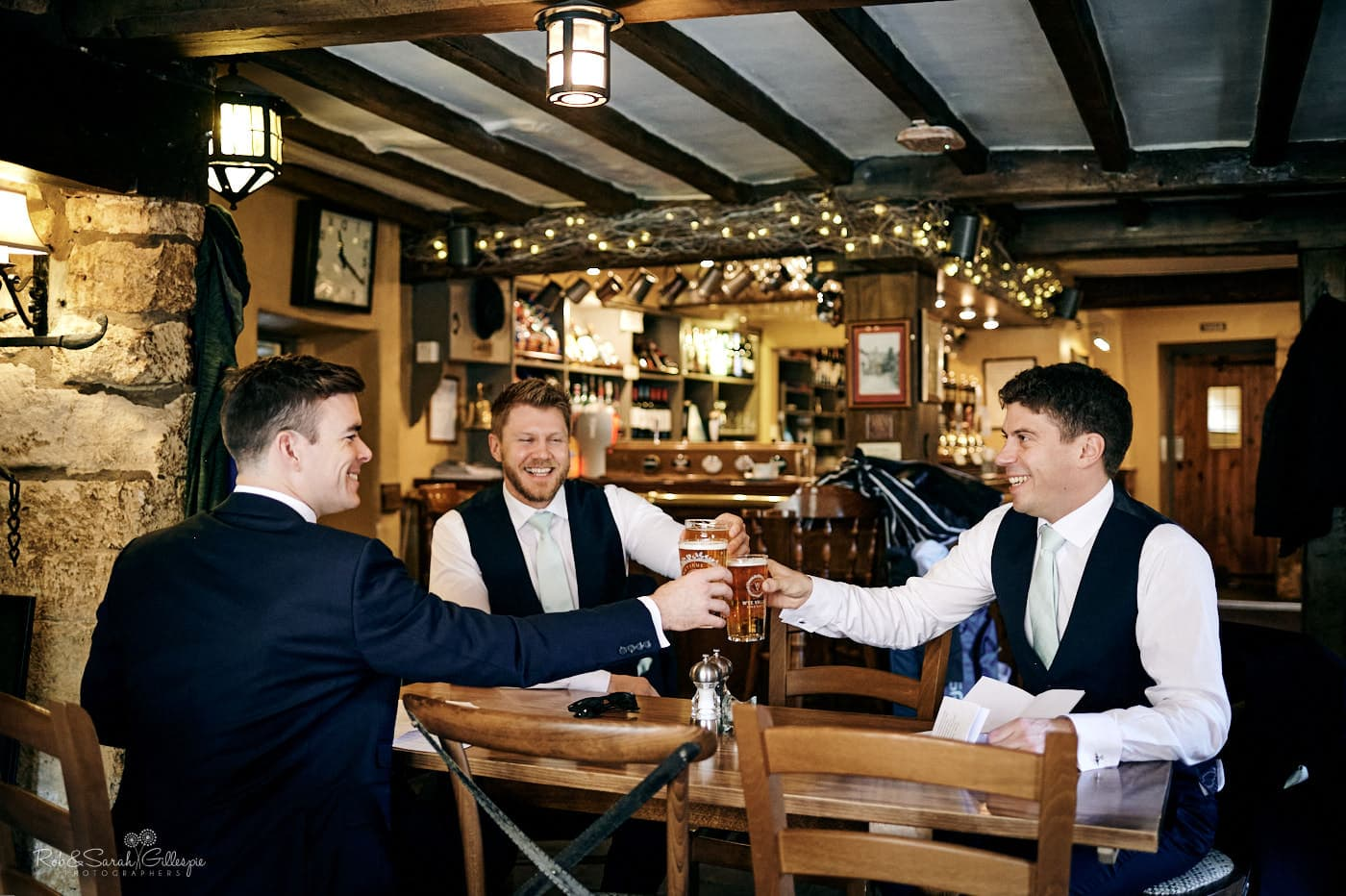 Groom and grooms men in bar at Eight Bells Inn
