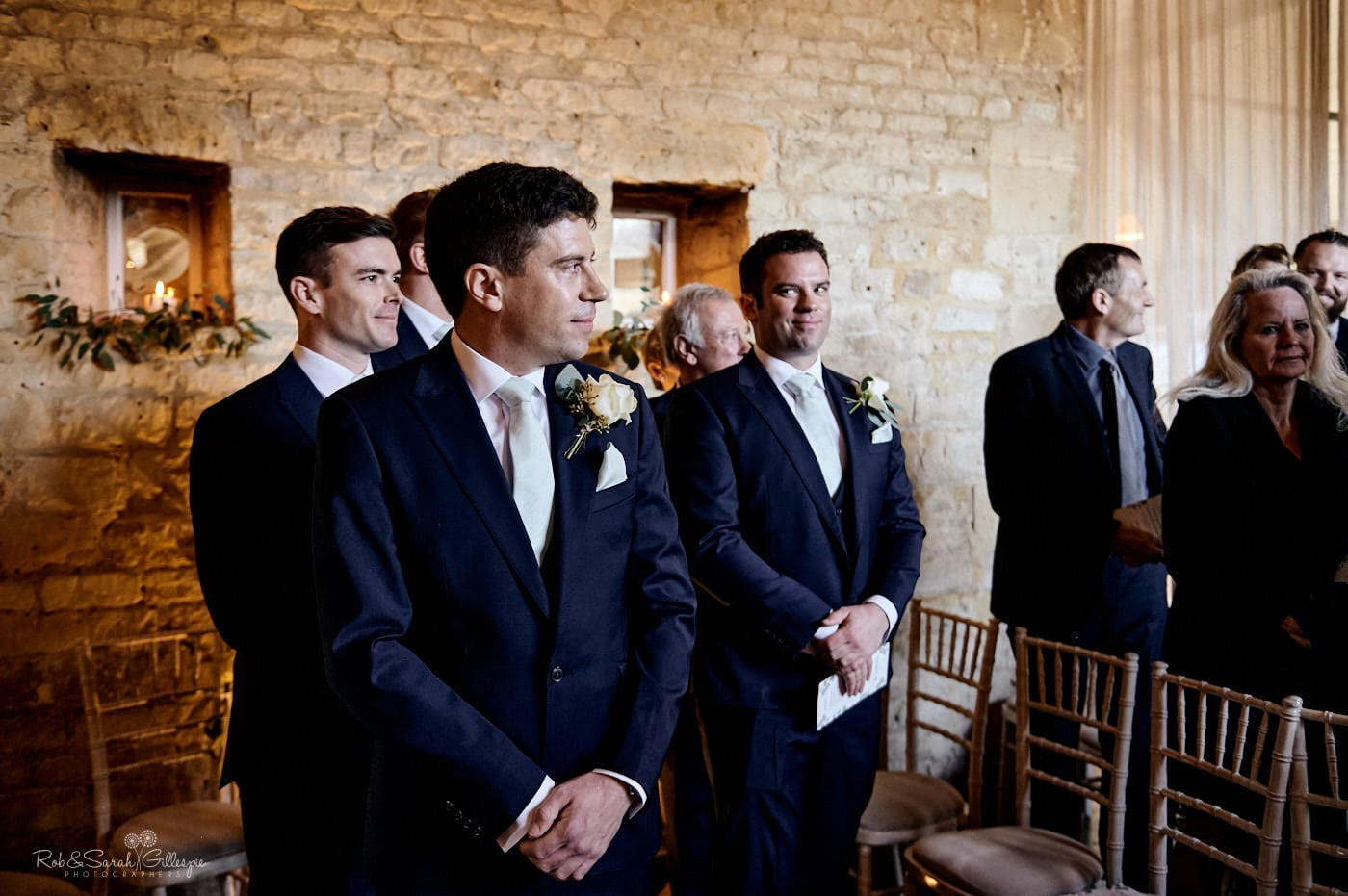 Groom waits for bride at Lapstone Barn wedding