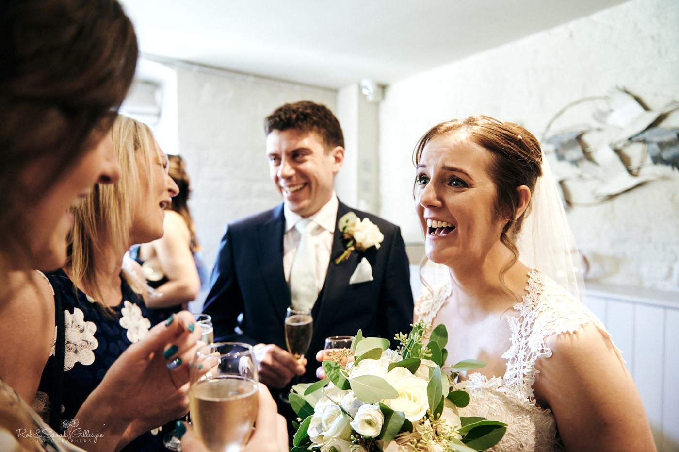 Bride and groom congratulated by guests at Lapstone Barn