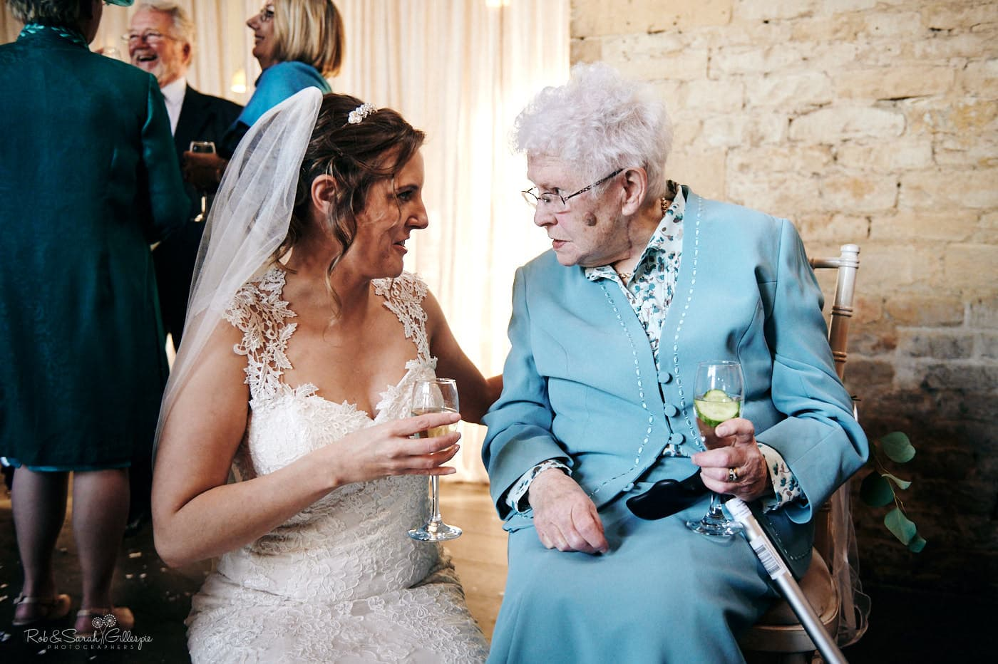 Bride chats to grandmother at wedding