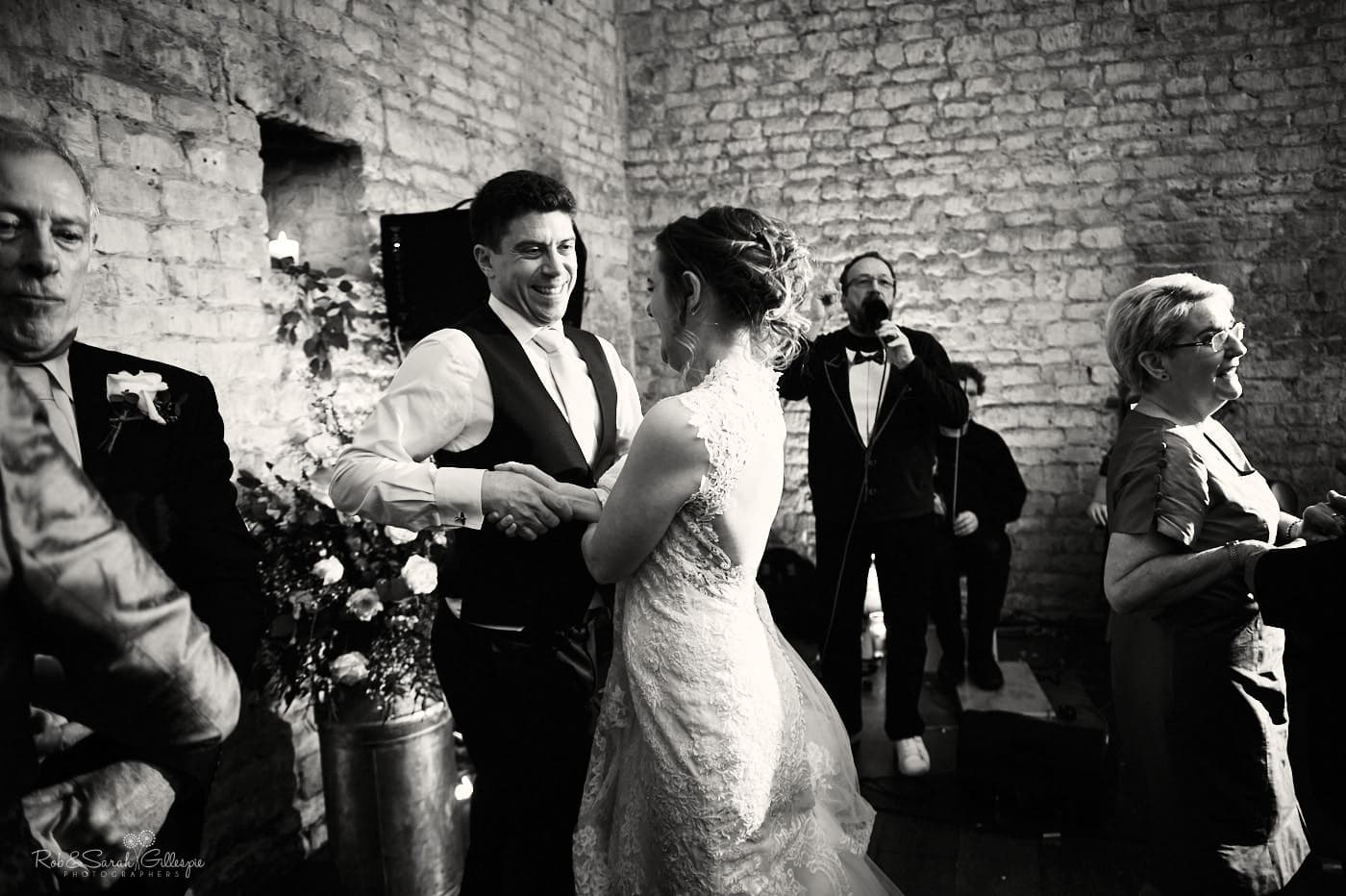 Ceilidh dancing at Lapstone Barn wedding