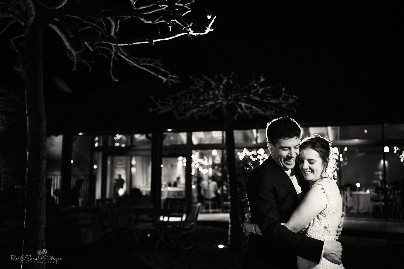 Bride and groom outside Lapstone Barn at night