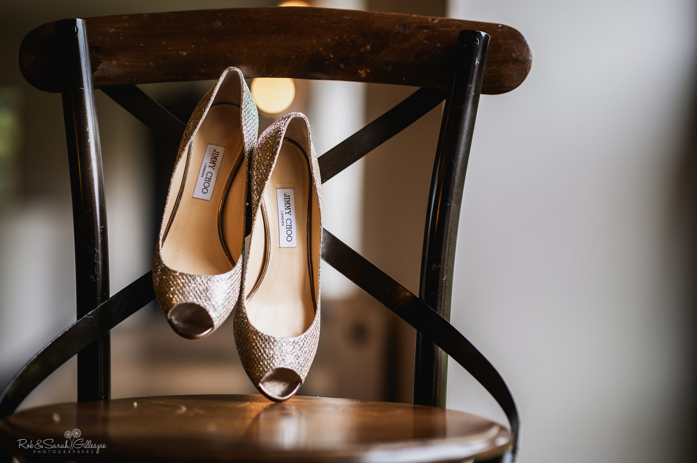 Jimmy Choo wedding shoes on a chair
