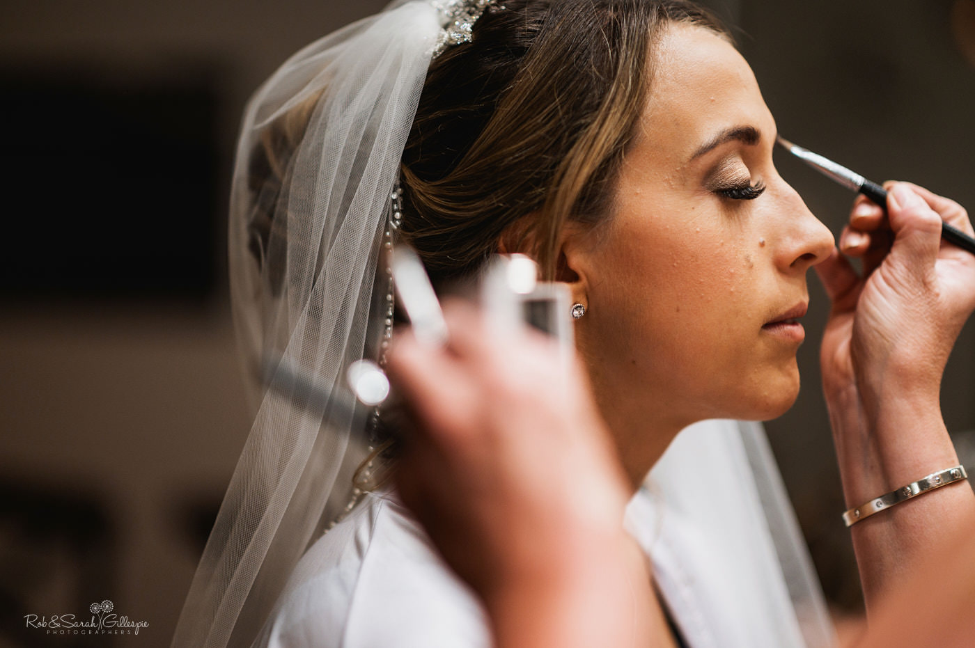 Bride has makeup applied