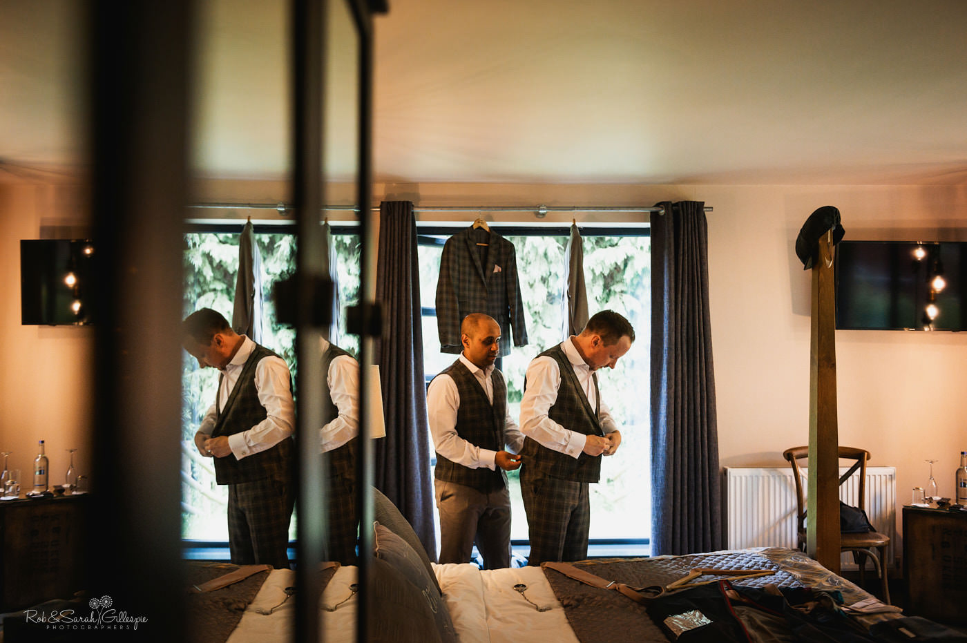 Groom and friends prepare for wedding at The Mill Barns