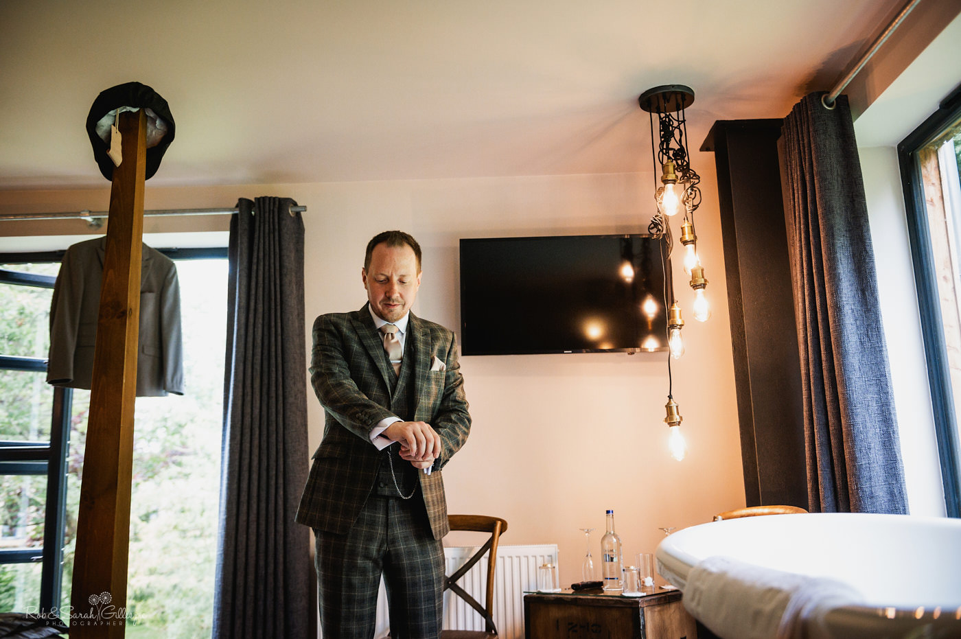 Groom gets ready for wedding in bridal suite at The Mill Barns