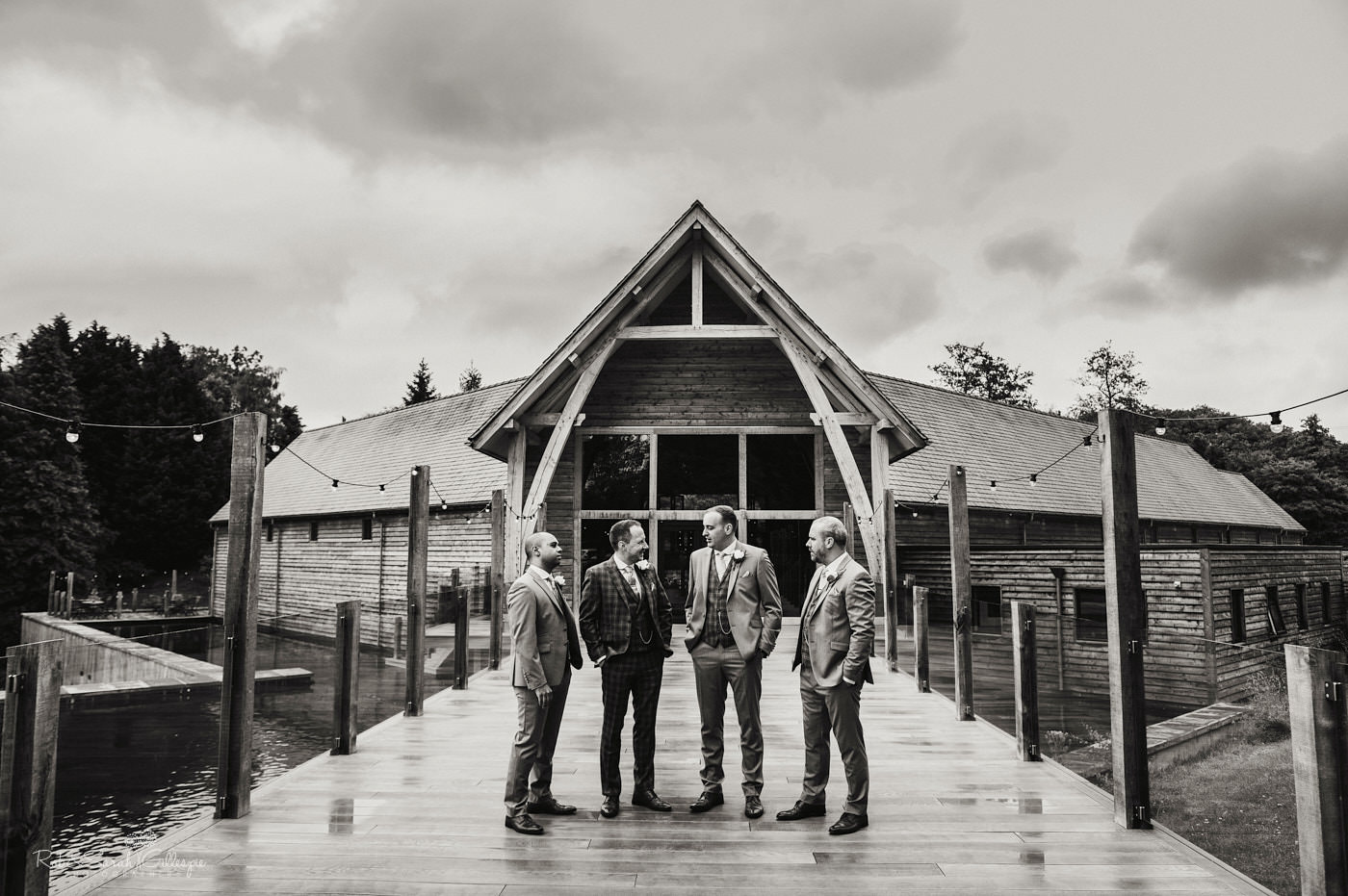 Groom and groomsmen outside The Mill Barns wedding venue in Shropshire