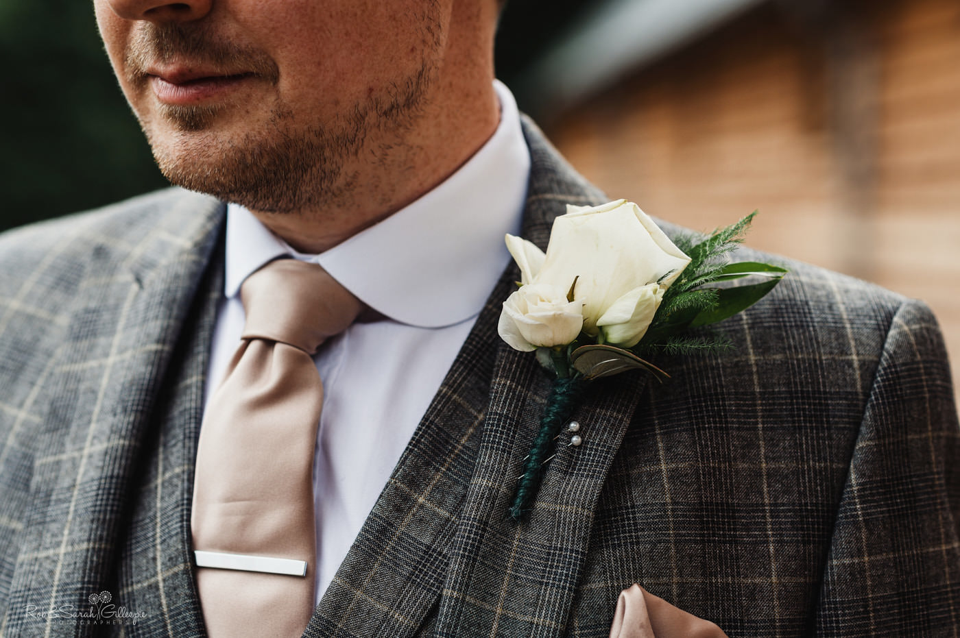 Close up of groom's buttonhole flower