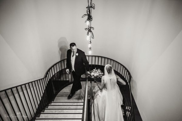 Bride and father on staircase at The Mill Barns