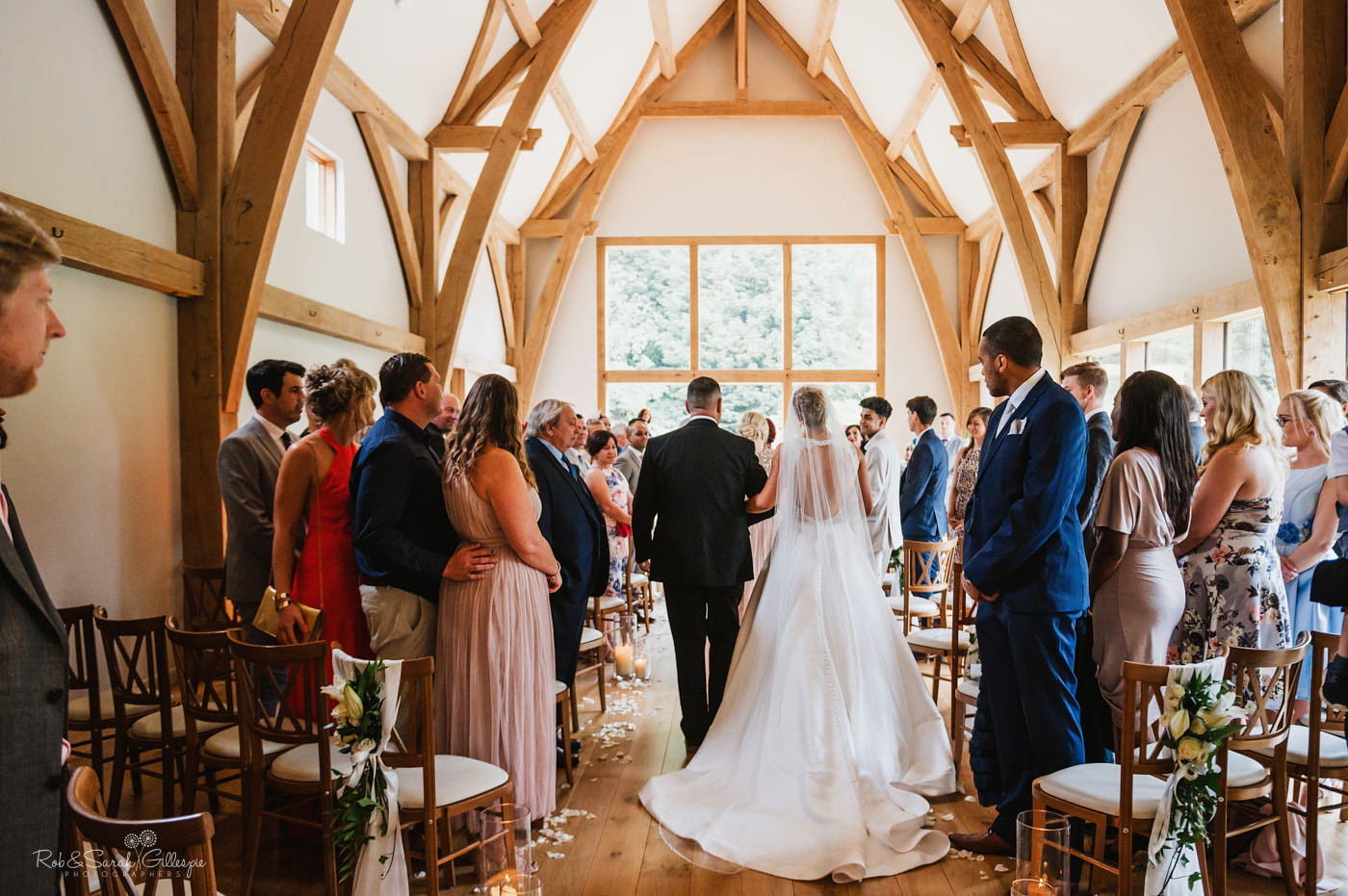 Bride walks up aisle at The Mill Barns wedding ceremony