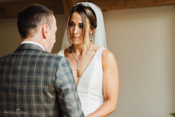 Bride listens to wedding vows