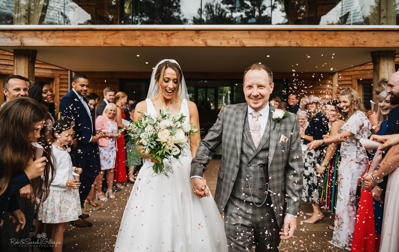 Confetti thrown at wedding. Mill Barns wedding photography