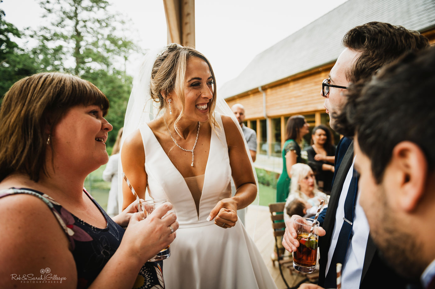 Bride chatting to guests at Mill Barns wedding