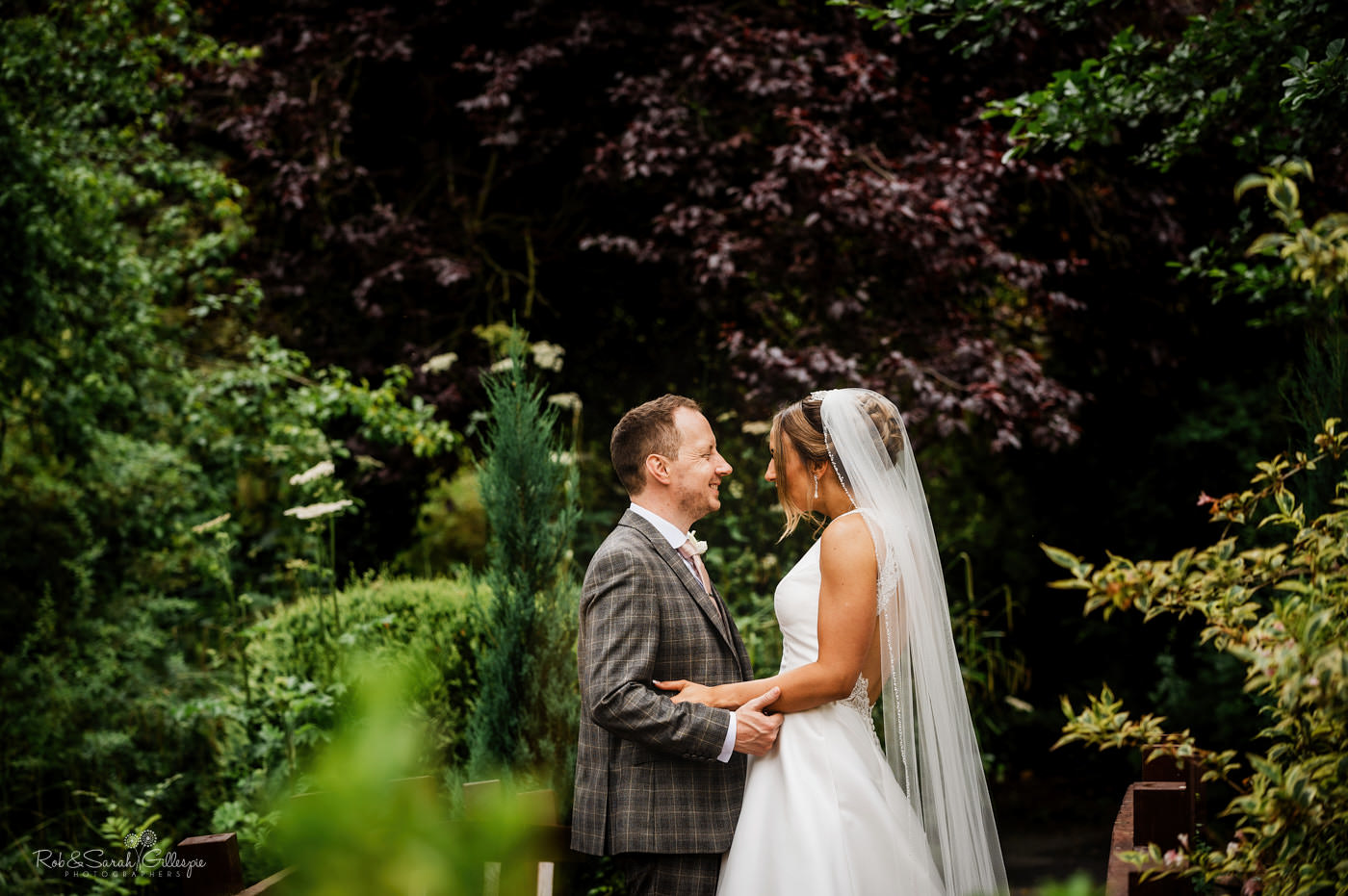 Bride and groom in gardens. Mill barns wedding photography.
