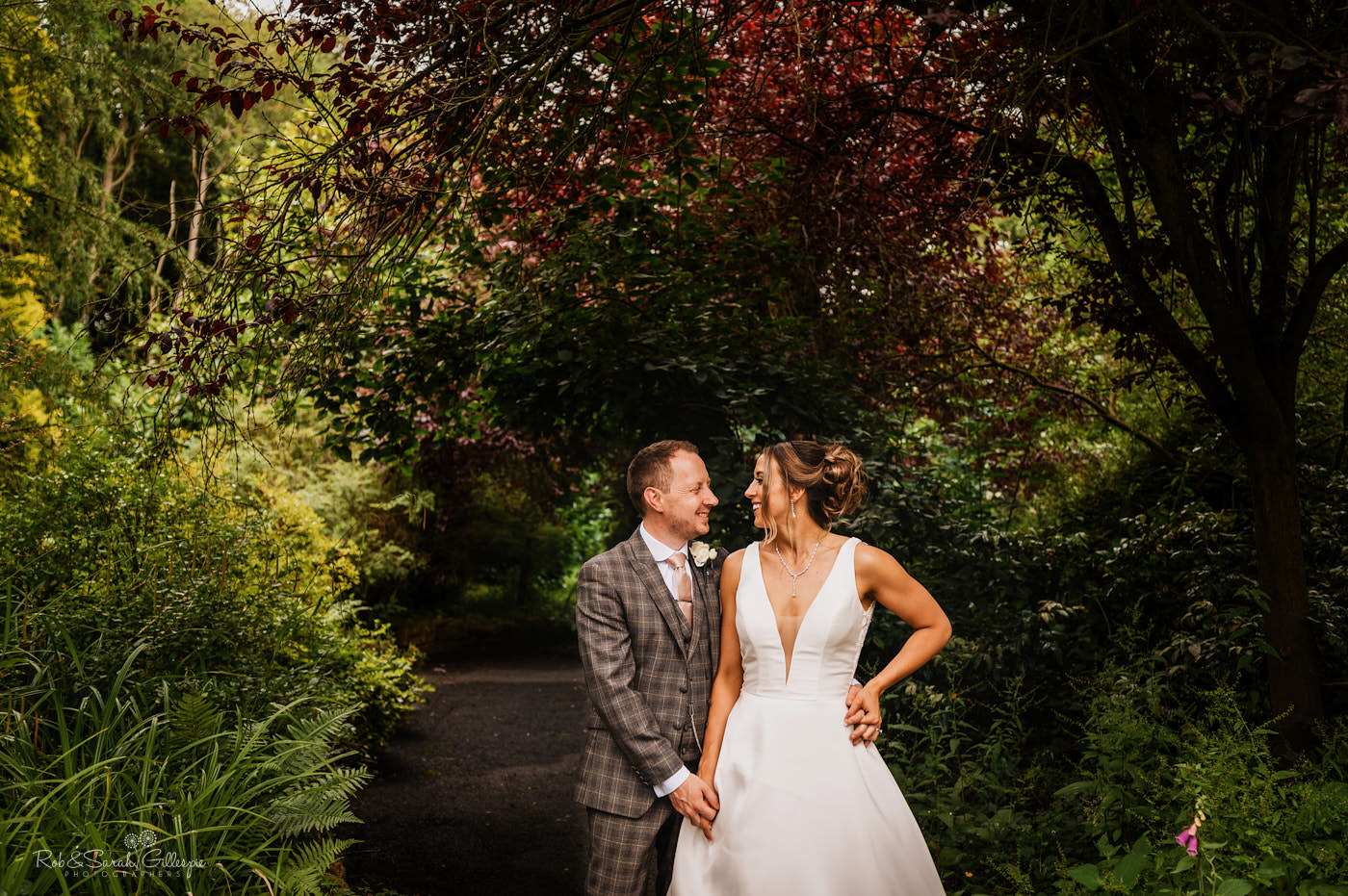 Relaxed couple in gardens. Mill Barns wedding photograpghy