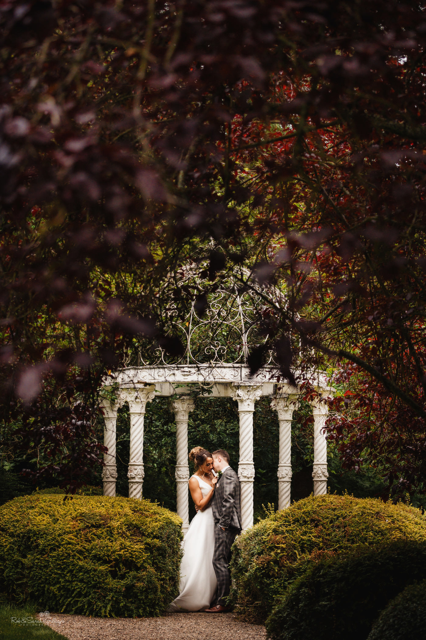 Bride and groom together in gardens at The Mill Barns in Shropshire
