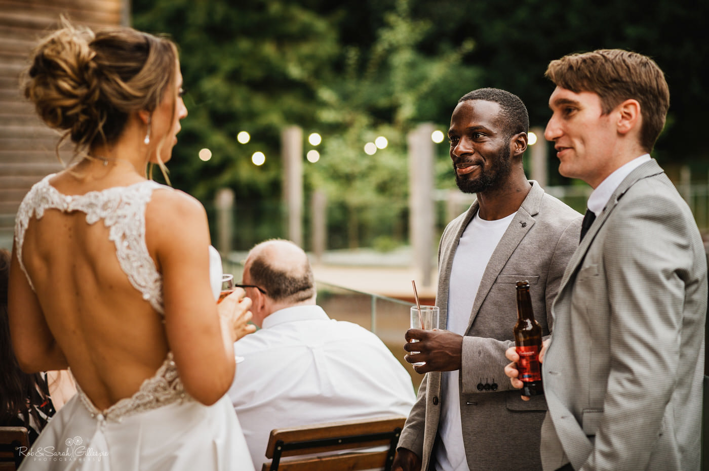 Wedding guests chat at evening reception