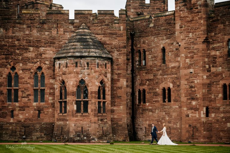 Bride and groom walking at Peckforton Castle