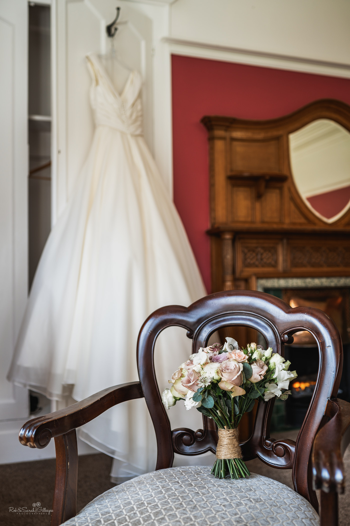Wedding bouquet with wedding dress behind