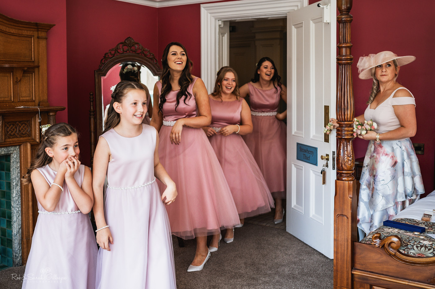 Bridesmaids see bride in dress for first time at Pendrell Hall