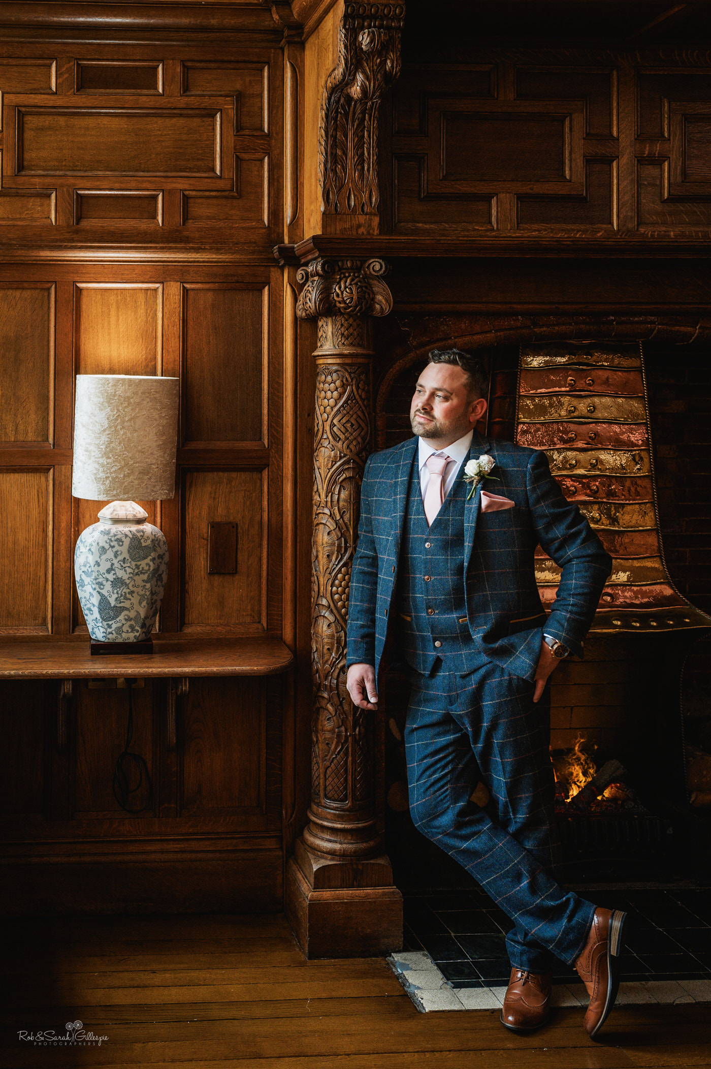 Groom portrait at Pendrell Hall with beautiful wood panelling