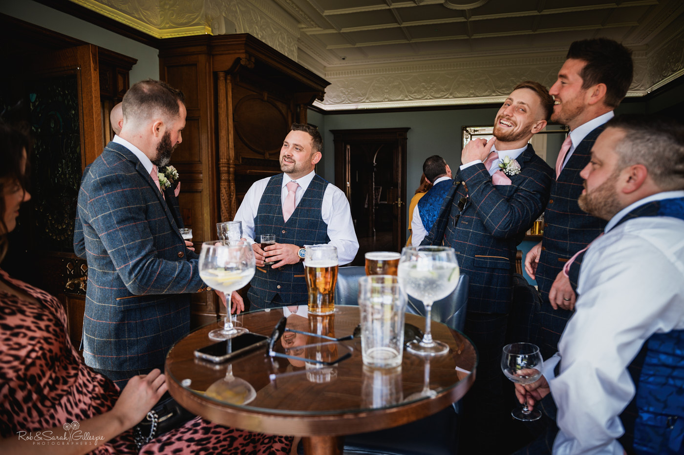 Groom has drink at Pendrell Hall before wedding