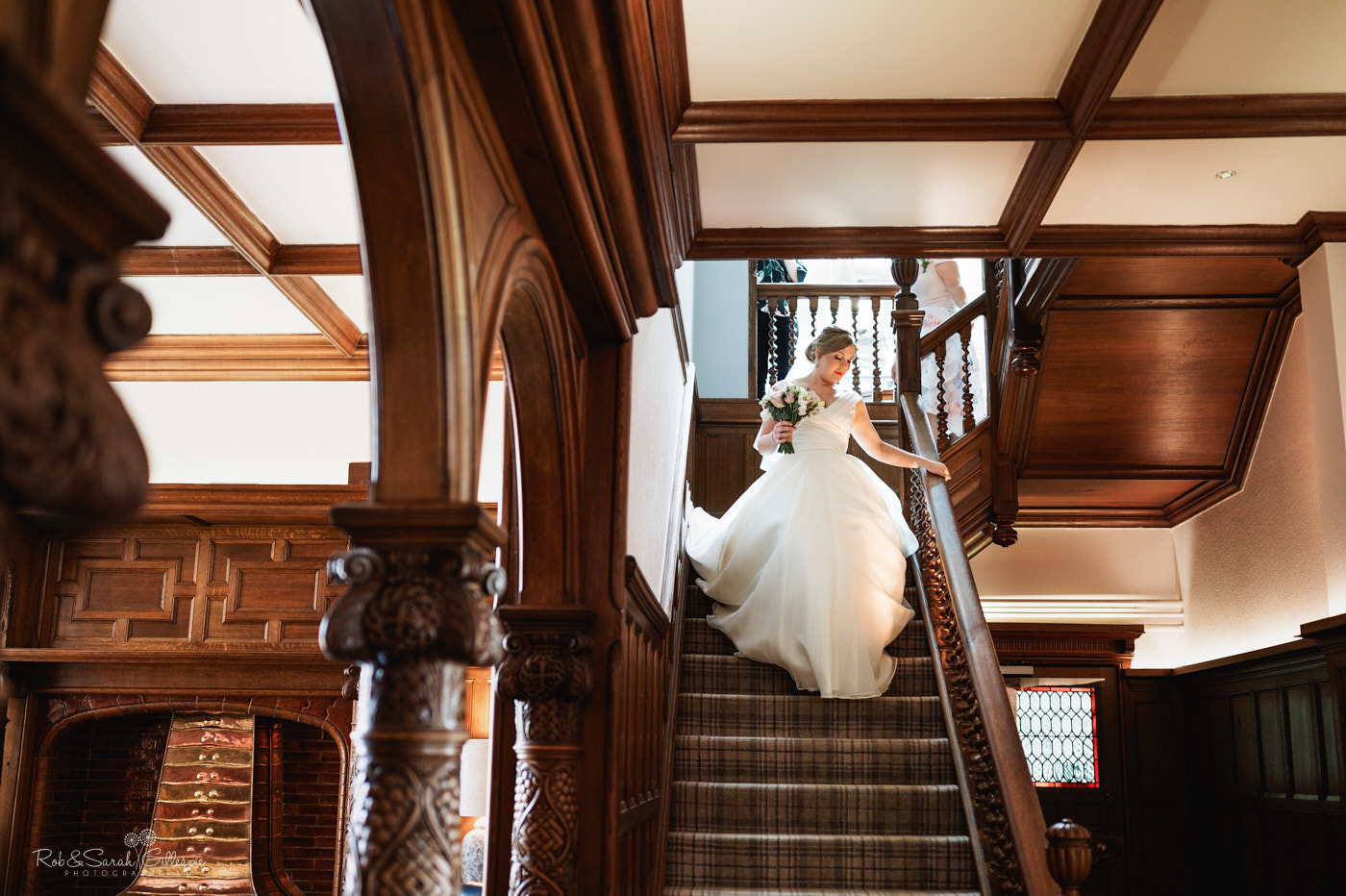 Bride descends staircase at Pendrell Hall