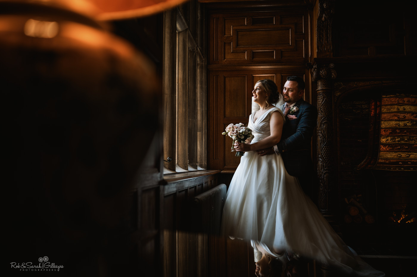 Bride and groom in beautiful window light at Pendrell Hall
