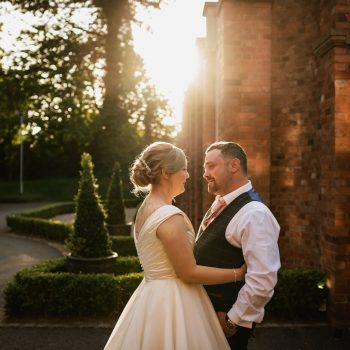 Bride & Groom outside Pendrell Hall in beautiful evening light