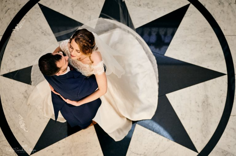Bride and groom on patterned marble floor at Spring Grove House