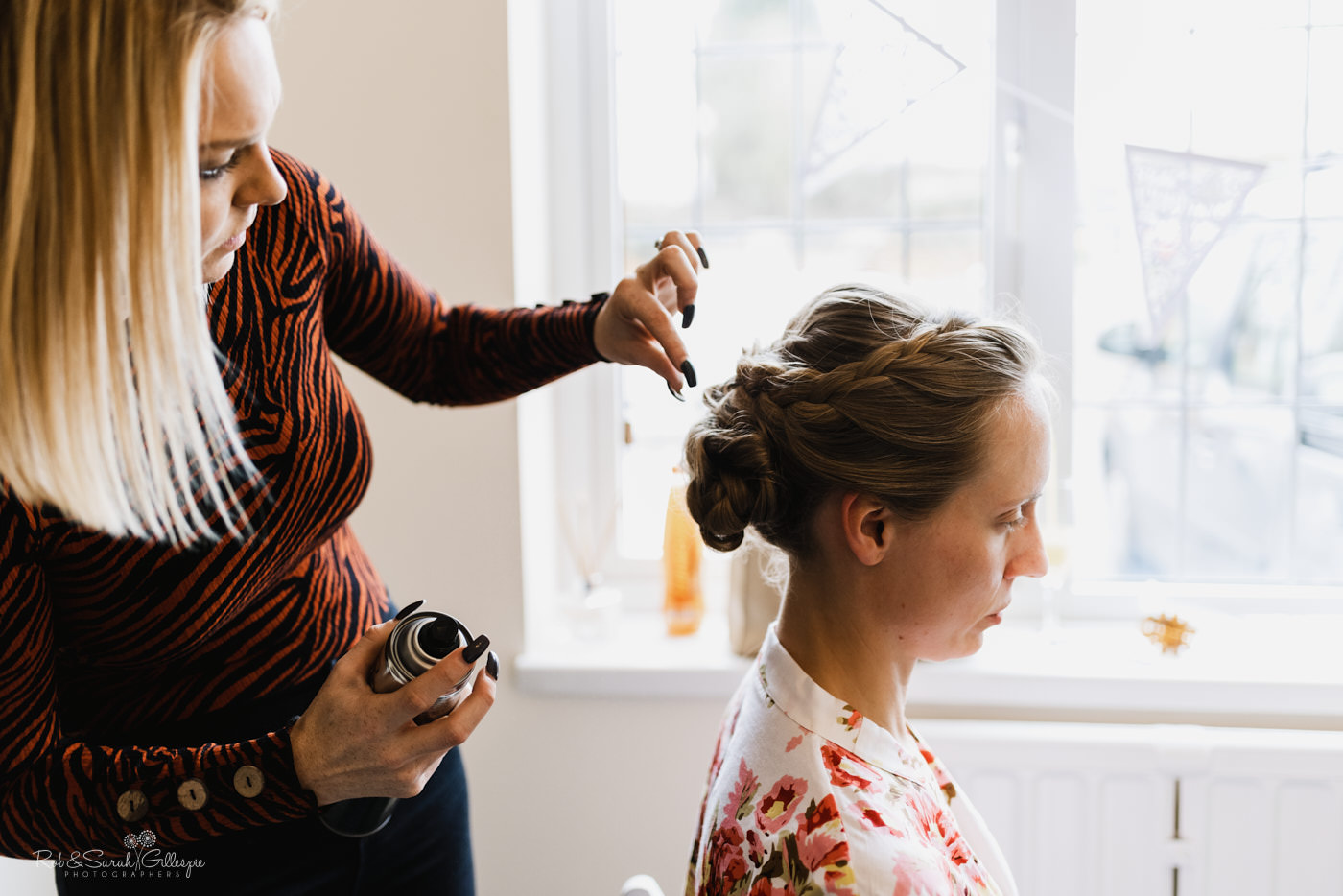 Bride has hair styled for wedding at St Kenelm in Worcestershire