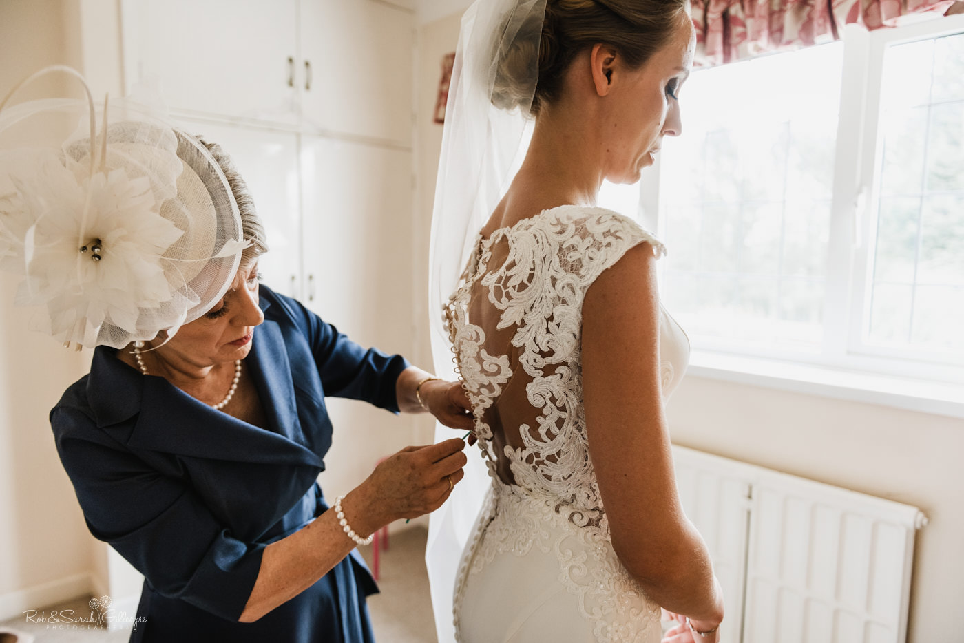Bride preparing for wedding at St Kenelm's church in Romsley, Worcestershire