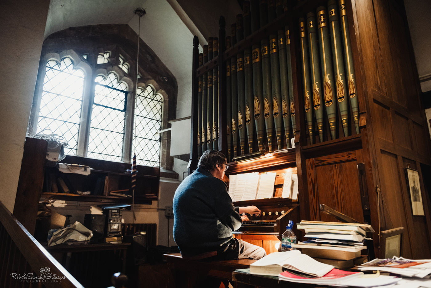 Organist plays pipe organ at St Kenelm's church in Romsley, Worcestershire