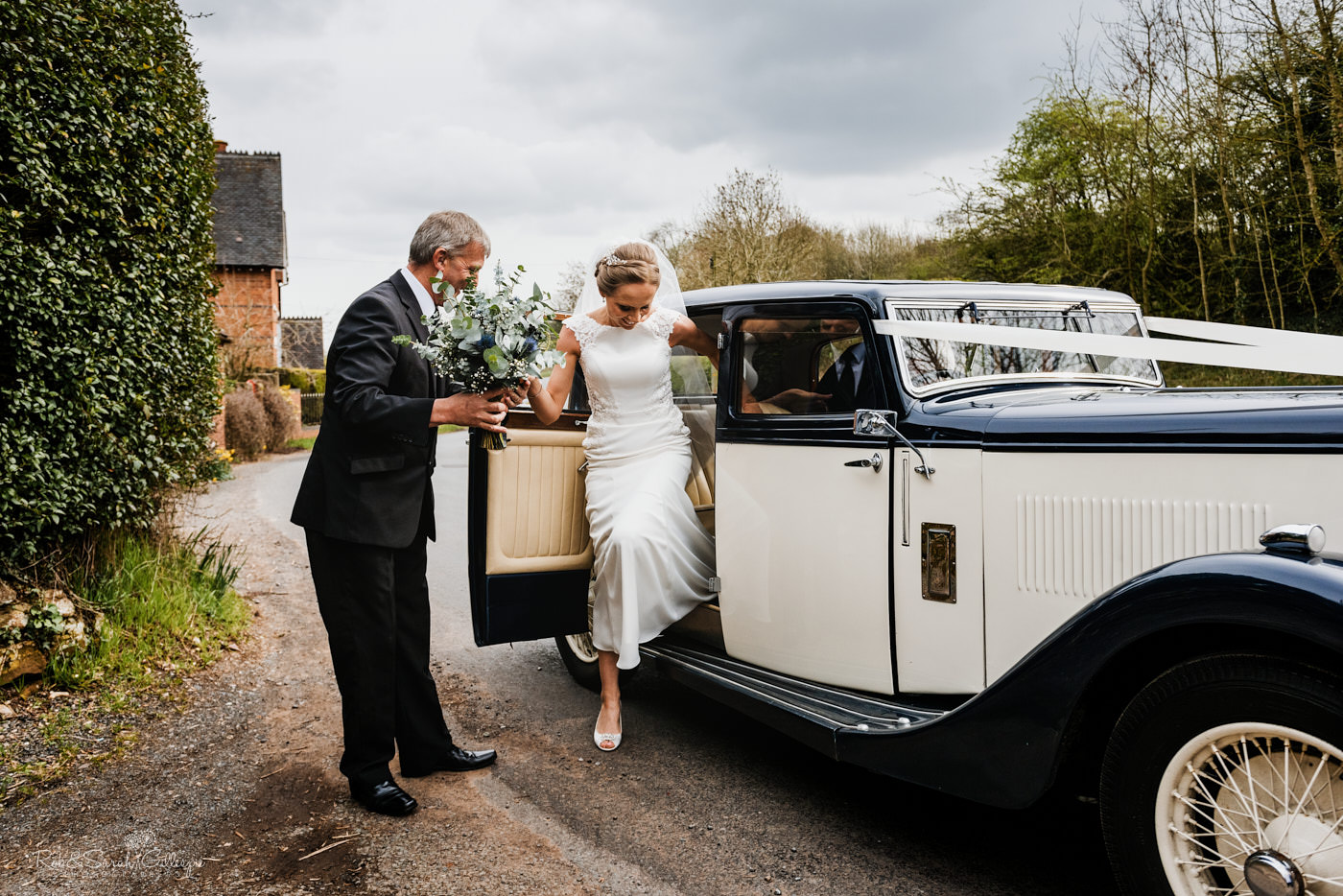 Bride arrives for wedding at St Kenelm in Romsley, Worcestershire
